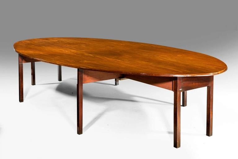 A magnificent George III period hunt table, the tops of three matching single timbers the plain square supports on gate leg sections. A truly outstanding and rare object.