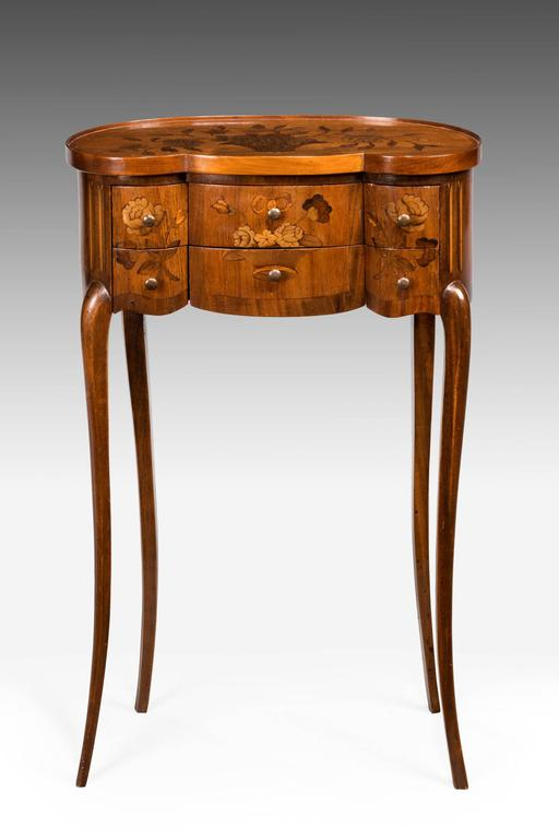 Late 19th century Continental marquetry commode. The top and front inlaid with flowers. On very slender supports. Triple serpentine front with a well shaped top. Very fine slender gallery.
