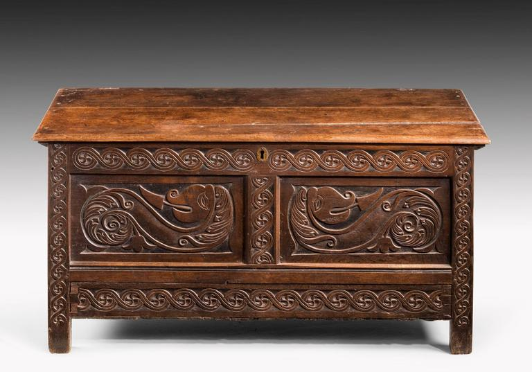 A very well carved Charles II period oak dower chest of good size. The sharply incised carving with top and bottom matching borders. Excellent overall colour and patina.  N.