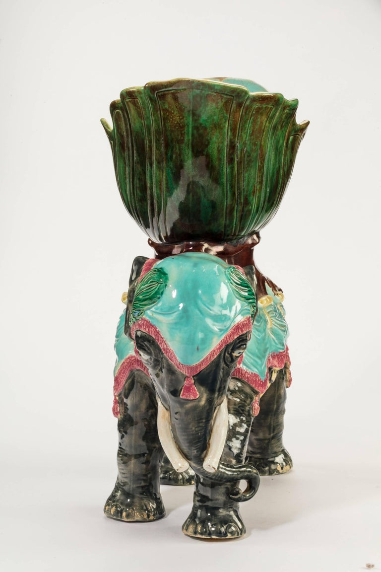 An unusual Majolica pottery elephant caparisoned with jardinière. Excellent overall condition.