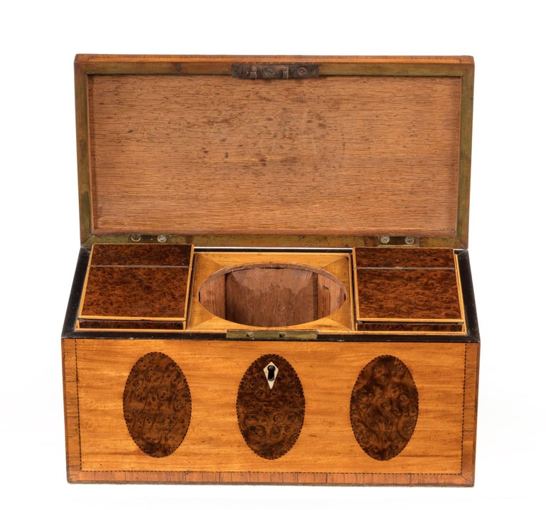George III period Satinwood and burr yew tea caddy. Of quite exceptional quality. The interior with two original lidded burr yew containers. The central mixing bowl now missing.