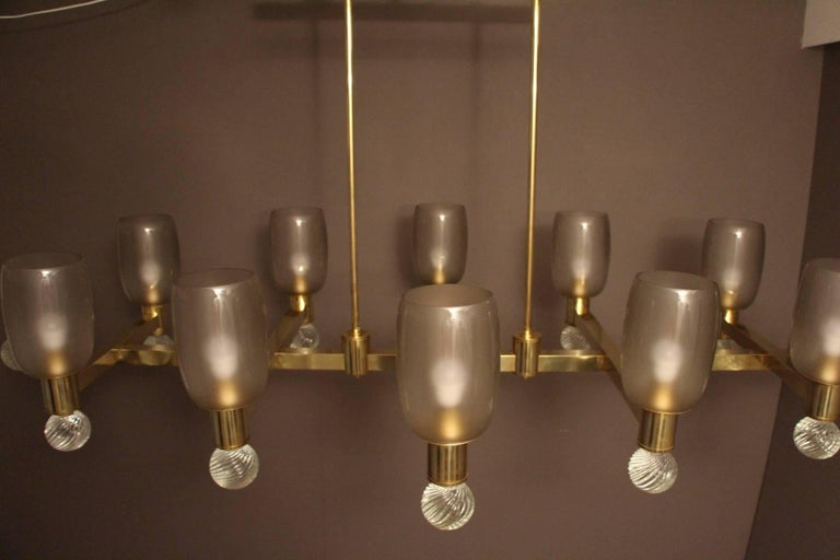 Large Architectural Oval Shaped Brass and Grey Murano Glass Ten-Light Chandelier For Sale 4