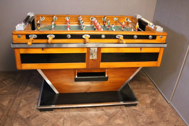 This magnificent French beechwood and ebonized table on shaped supports has got painted steel players, four crystal ashtrays by Lalique and polished aluminum fittings. It is a beautiful decorative piece as well as a fabulous game table in working