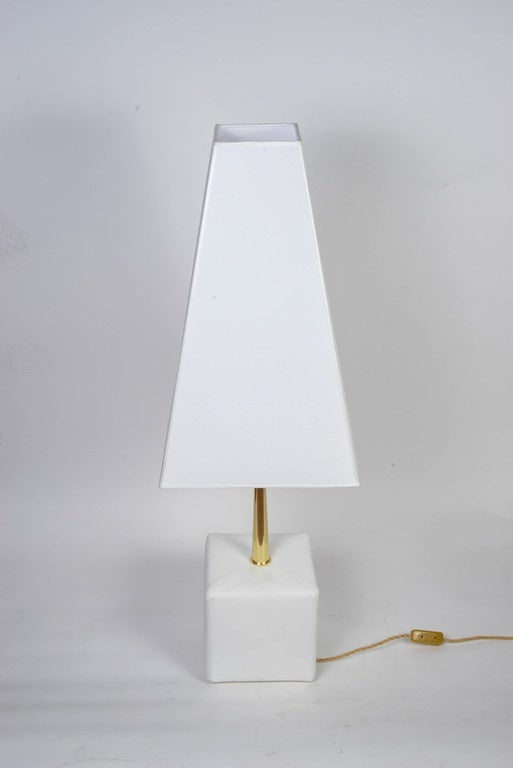 Pair of lamps designed by Angelo Brotto and made by Esperia editions. Each lamp is made of a leather white square and a shining brass stem, finished by a tall shade.