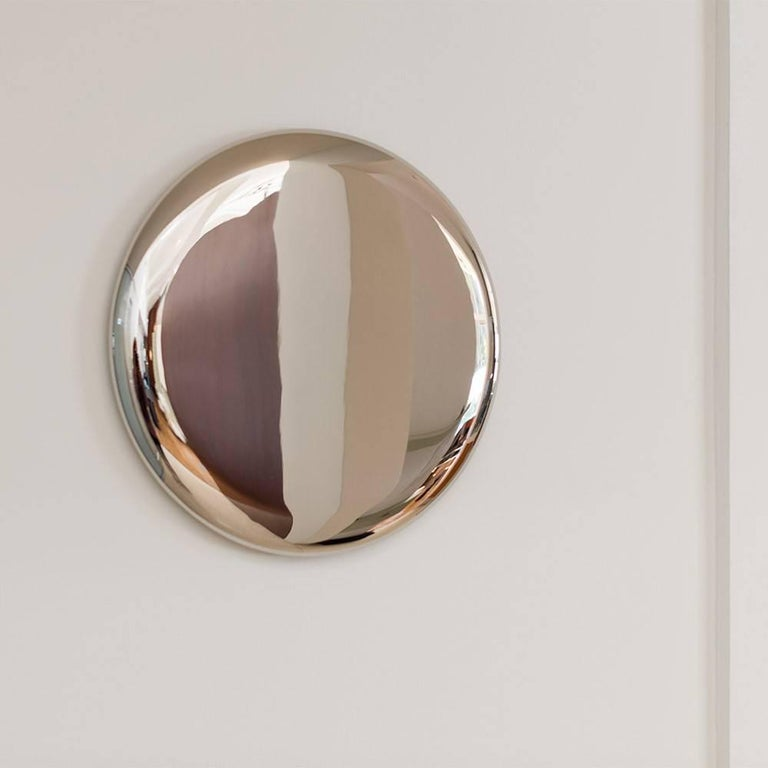 Hand made, these sleek beauty mirrors are crafted using stainless steel and gold plating.   Michael Anastassiades produces exceptionally designed objects of permanent value, combining fine detailing and honest expression to reinforce the elegance