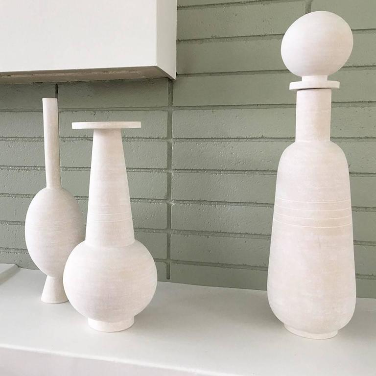 With a focus on handcrafted ceramic objects, Eric Roinestad produces unique sculptural objects, home accessories, furniture and lighting. The current collection takes inspiration from both the natural landscape of Southern California and the design