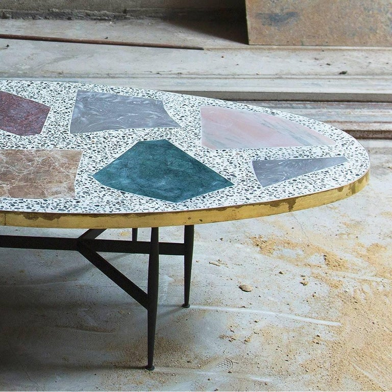 The magic stone coffee table from rooms pairs an almost Primitive-looking stone tabletop with thin steel legs. The interplay between the tabletop – with its elemental mosaic of inlaid stones – against the table's slim-line Silhouette, gives it the