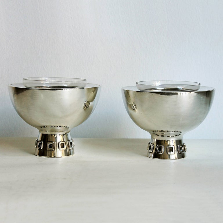 Pair of caviar bowls, sterling silver with glass little bowls, square decoration on base. Weight: 287 grms (without glass) each Design: Puig Doria Spain, Barcelona, circa 1960.