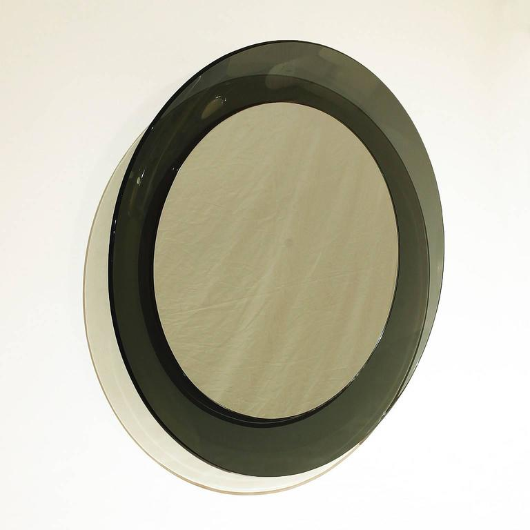 Spectacular mirror with original green gray rounded cristal frame.  Maker: Cristal Art.  Italy, circa 1960.