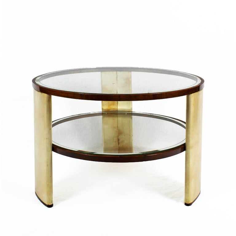 Rare Art Deco side table with three parchment covered wood stands with walnut bases. Two glass trays with mirror strips, one inserted at mid height and the other one on top of stands, French polish,  Italy, circa 1930  The table is in good