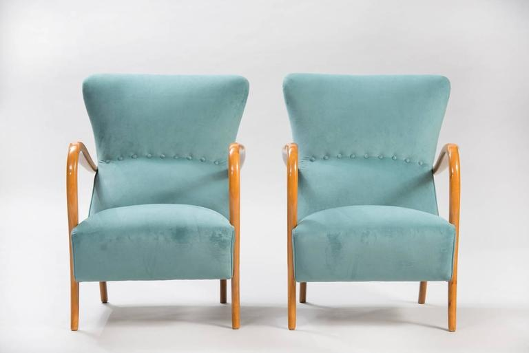 Pair of armchairs, re-upholstered in blue velvet.