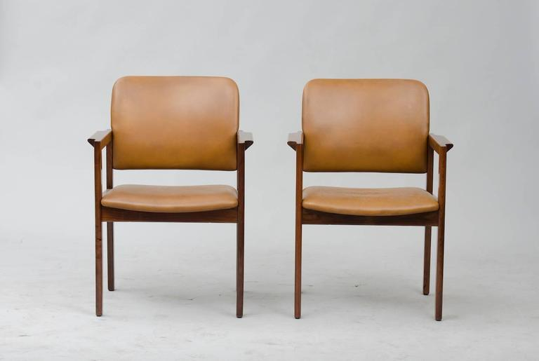 Set of six rosewood and brown leather armchairs. Producer: Bjerringbro kontormøbler A/S.