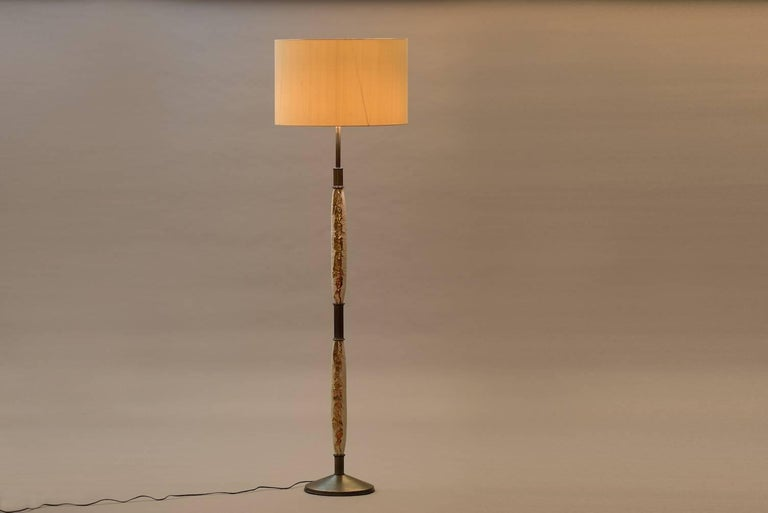 Floor lamp with Egyptian inspired ceramic motifs, brass and a new silk shade. Measures: Diameter 55 cm (shade).
