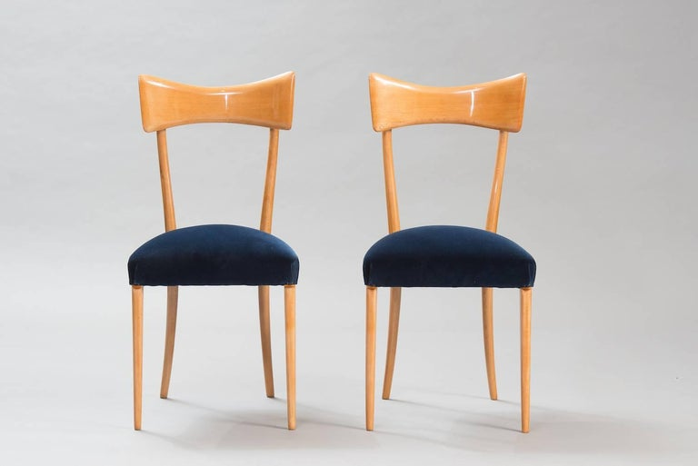 Set of six beech high back dining chairs in the style of Ico Parisi reupholstered in dark blue velvet.