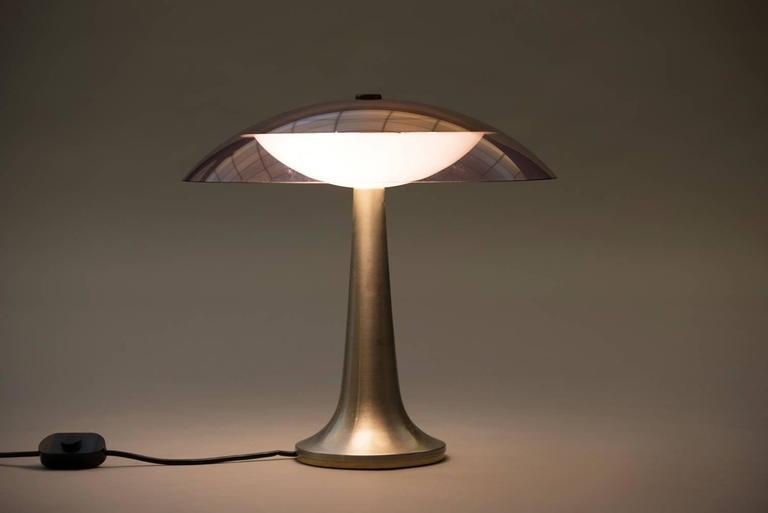 Aluminium and plexiglass table lamp.