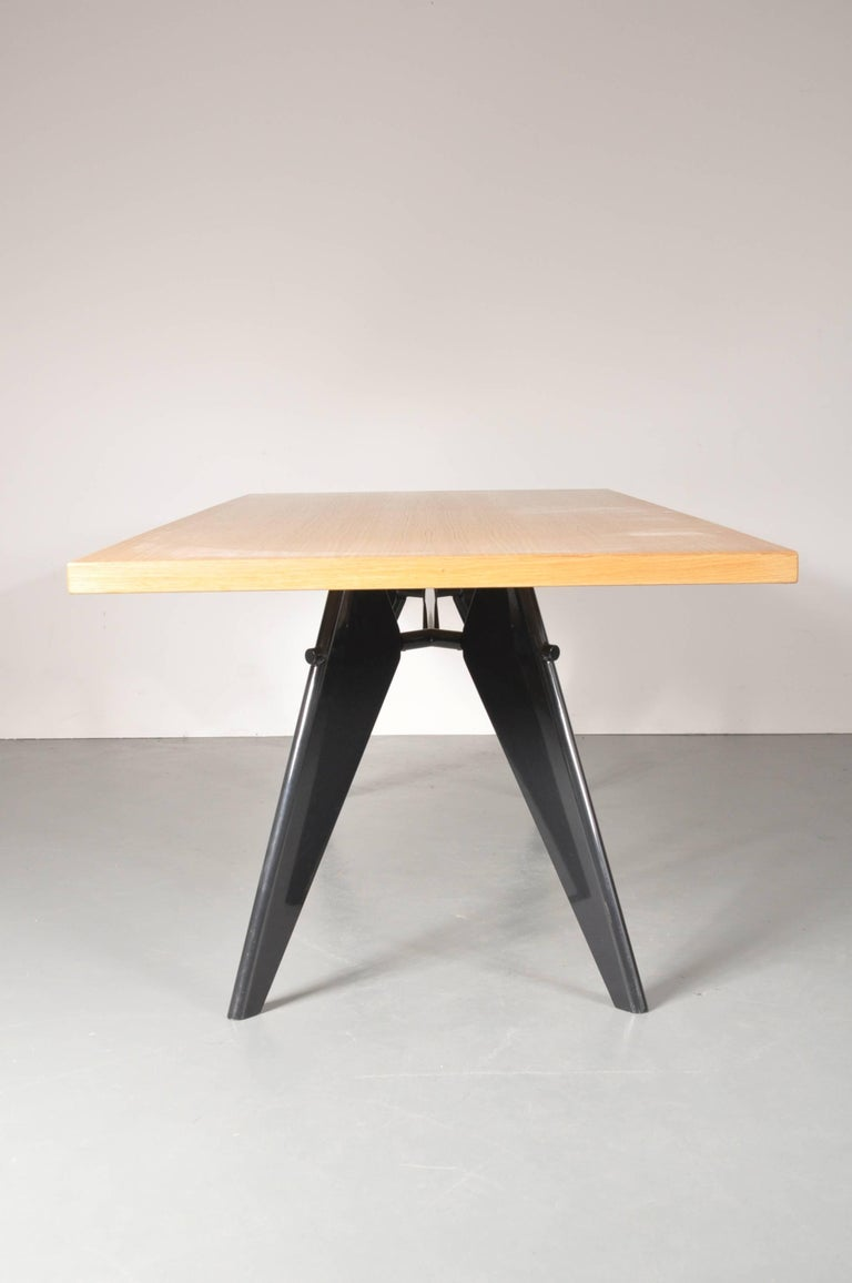 A beautiful dining table, famous design by Jean Prouvé, manufactured by Vitra in Germany, circa 2002.