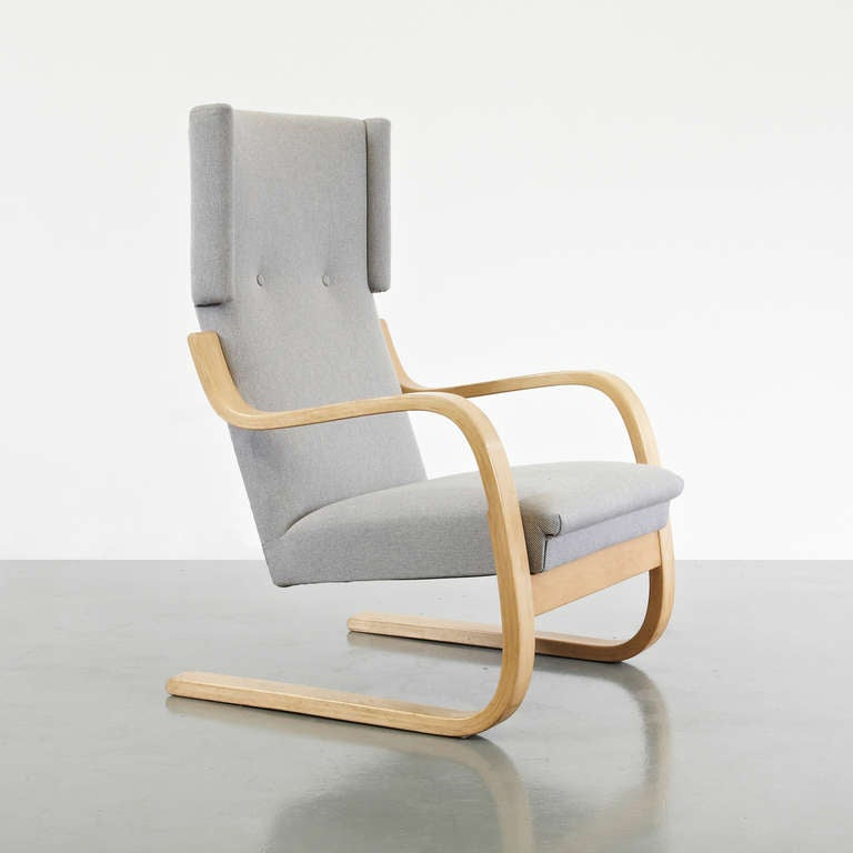 Wingback lounge chair, model 36/401 designed by Alvar Aalto in 1933. Produced by Artek (Finland) in, circa 1950. Bent laminated birch base and armrests, deep foam rubber seat and backrest upholstered in fabric, original excellent