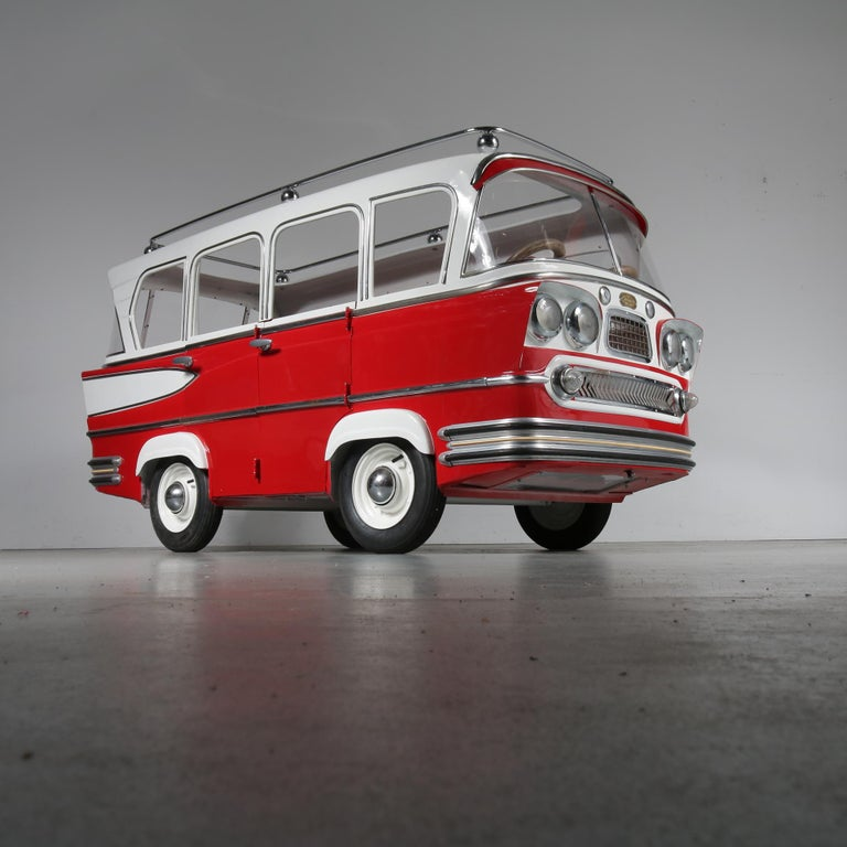 A unique, very rare carousel bus designed by Karel Baeyens, produced by l'Autopede in Ghent, Belgium, circa 1955.  This eye-catching piece has been beautifully renewed after it's original standards. It is made of metal, painted in a beautiful