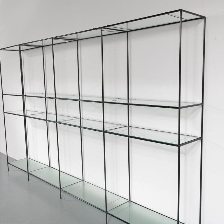 Amazing large Abstracta system cabinet designed by Poul Cadovius in Denmark, circa 1950.  This beautiful modular cabinet draws its beauty from its simplicity. It has a strong black lacquered metal structure with separate joints and glass plates,