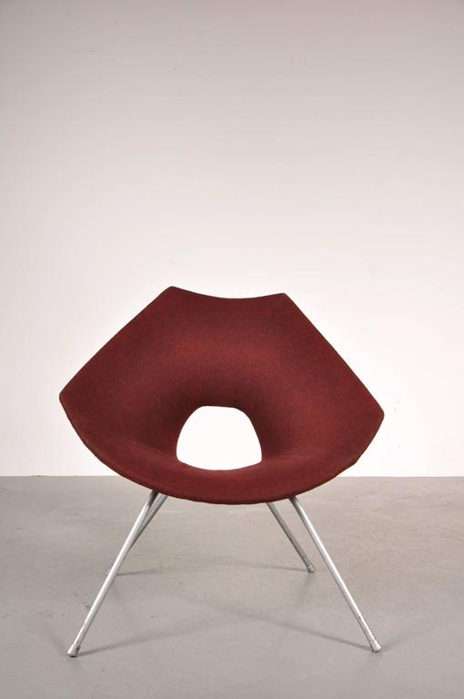 Stunning easy chair by Augusto Bozzi, manufactured by Saporiti in Italy around 1950.  The chair has a high quality grey lacquered metal base and the original deep red upholstery. This iconic piece of design would fit perfectly in any modern