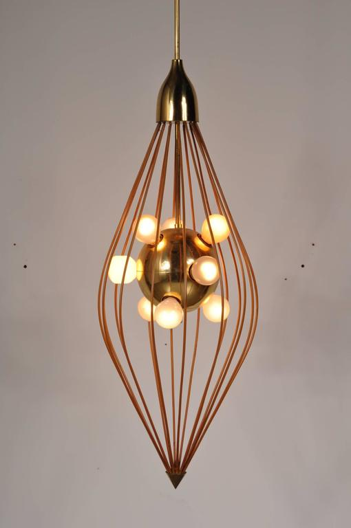 Stunning ceiling lamp in the style of Angelo Lelli / Arredoluce, manufactured in Italy, circa 1950.  The lamp is made of the highest quality brass. It is made of plastic covered metal rods in a diamond shape with several light bulbs in the middle.