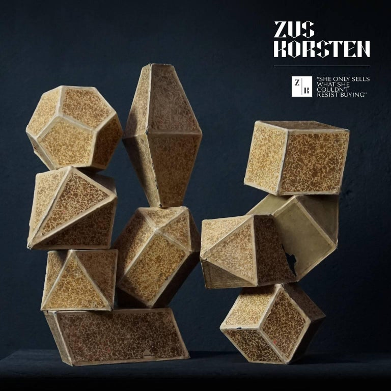 Nine large brown speckled cardboard crystal teaching forms.  These crystal models used to be used as teaching material at school, to show students the difference in crystal shapes. Crystals are commonly recognised by their shape, consisting of flat