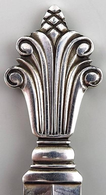 12 Georg Jensen acanthus sterling silver 12 coffee spoons.  Measures: 11.5cm.  Marked.  In very good condition.