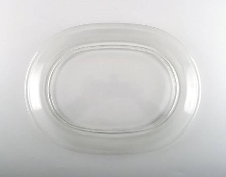 Lobster plates, five plates in clear glass by Josef Frank.  Produced at: Svenskt Tenn, Reijmyre / Gullaskruf,  Sweden, mid-20th century.  In good condition.  Measures: 30 cm. long.
