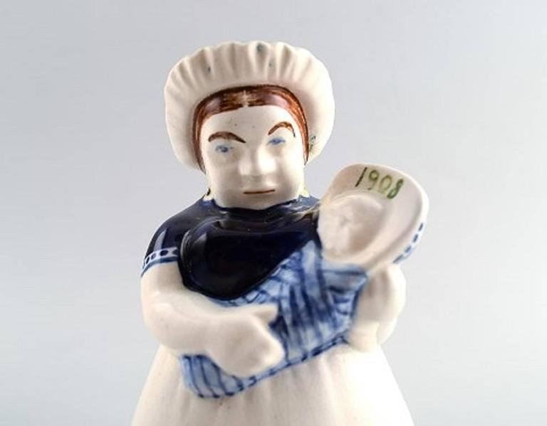 Rare Ame Aluminia/Royal Copenhagen figurine.  Dated 1908.  Height 14 cm.  Number 556/484.  Very good condition