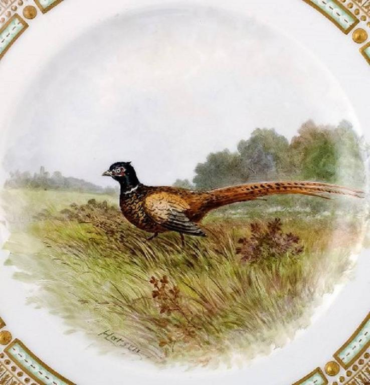 Royal Copenhagen Flora Danica / fauna Danica dinner plate with motive of a pheasant in landscape.  Painted in high quality. 25.5 cm. in diameter.  1. Quality, in perfect condition.  Model No. 40/3549.