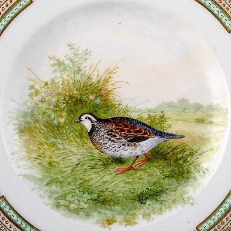 Royal Copenhagen Flora Danica / Fauna Danica dinner plate with motive of a bird in landscape.