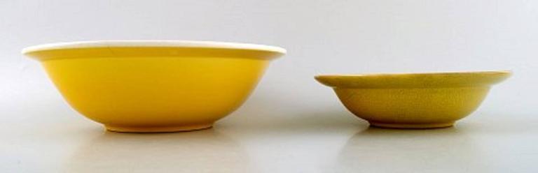 Four bowls, Susanne yellow Confetti Royal Copenhagen / Aluminia.  Measures: Largest 23.5 cm x 8 cm.  In good condition. 1st. factory quality.