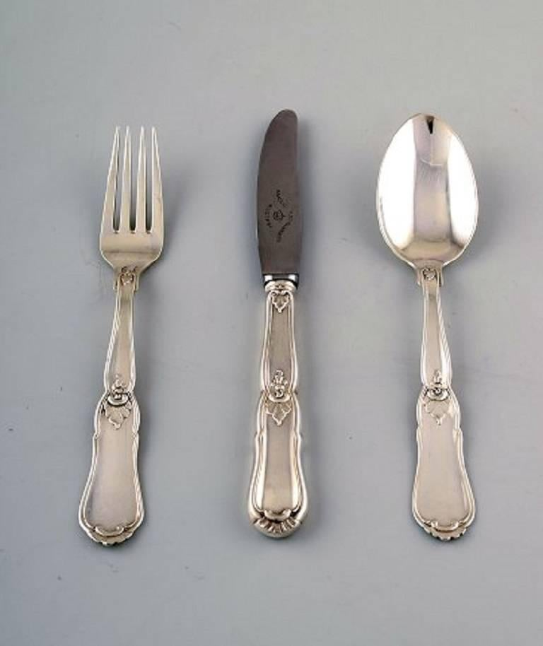 Complete Danish silver dinner service for 12 people.