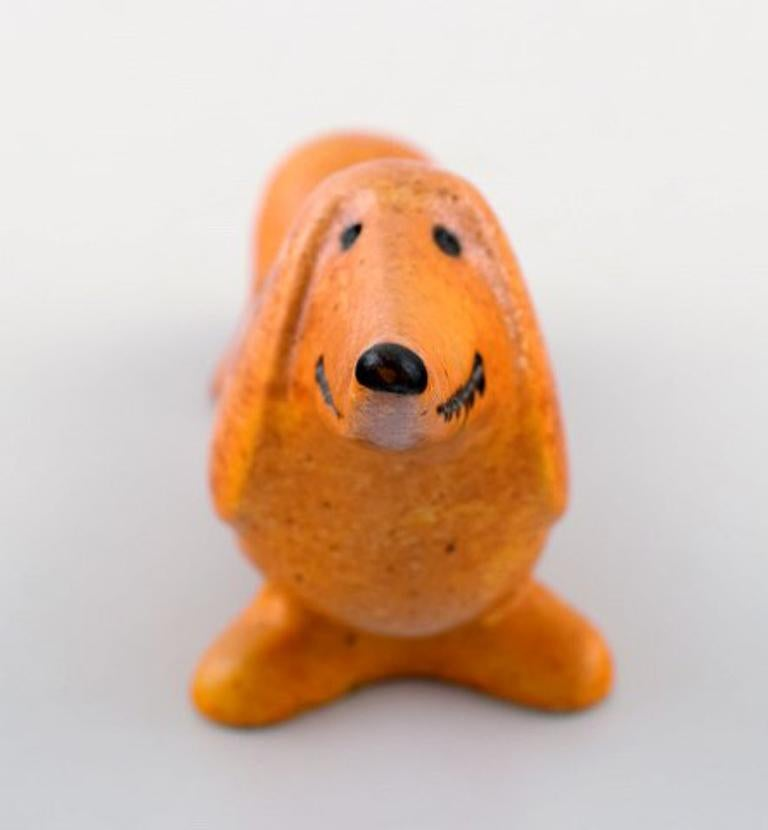 Lisa Larson for Gustavsberg. Stoneware figure of dog. Measures: 16 cm x 8 cm. In perfect condition. Stamped.