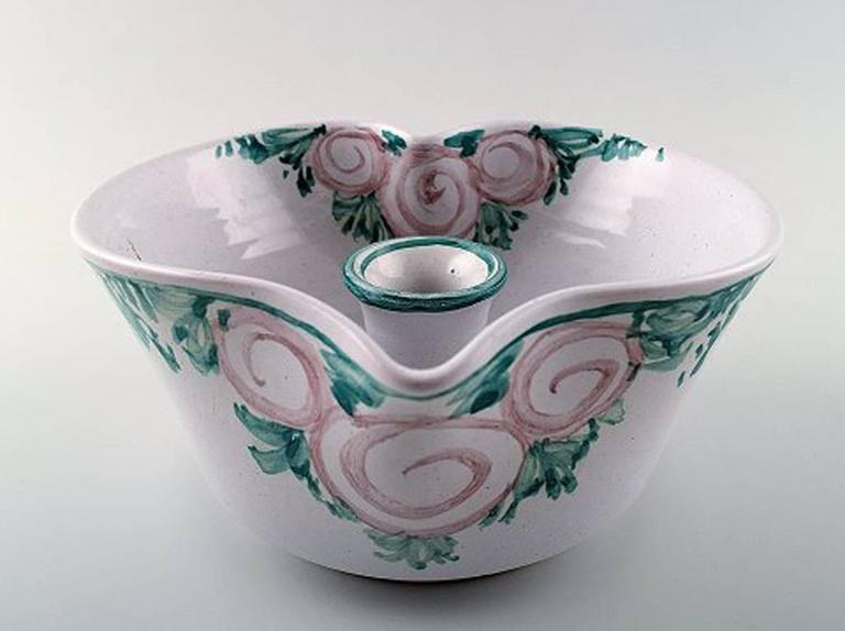 Bjorn Wiinblad unique ceramics candlestick, pink and green glaze.  Measures: 17 cm. x 9.5 cm. Model number L 202.  Dated 1988.  In perfect condition.