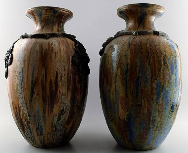 Roger Guerin (1896-1954) A pair of large French Art Deco ceramic floor vases with blackberry stalks in relief.  Very beautiful glaze.  In perfect condition.  Measures: 41 x 22 cm.  Marked.