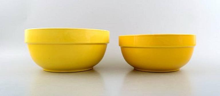 Four bowls, Susanne yellow confetti royal Copenhagen / aluminia.  Measures: Largest: 22 cm. x 10 cm. Smallest 15 x 7 cm.  In very good condition. 1st. factory quality.
