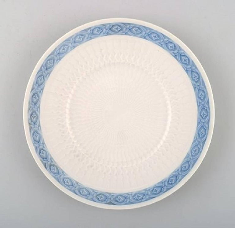 14 plates. Royal Copenhagen Blue fan, flat plates. Designed by Arnold Krog in 1909. Decoration Number 1212/11521. Measures: Diameter 19.5 cm. In perfect condition, 1st. factory quality.