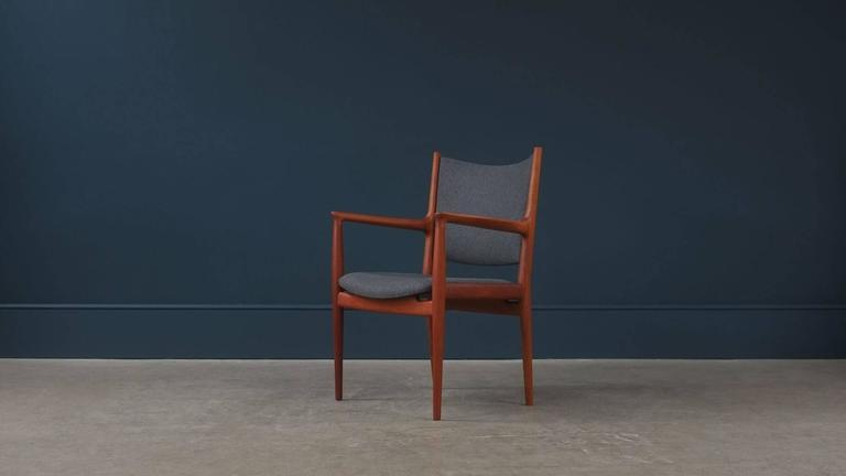 Beautiful JH713 armchair in solid teak designed by Hans Wegner for cabinet maker Johannes Hansen, Denmark. Fully reconditioned and re-upholstered in fantastic grey wool. Wonderful quality and super elegant chair.