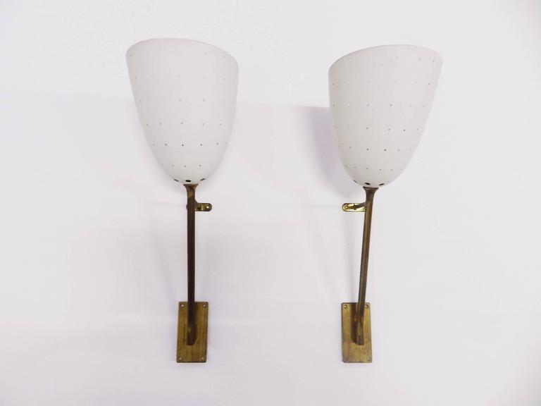 perforated pair of wall sconces at 1stdibs