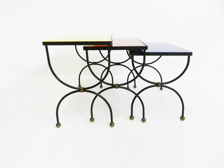 A gorgeous set of three nesting tables attributed to Jean Royère.