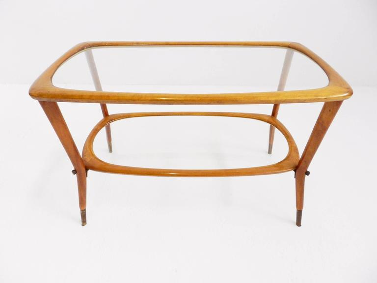 Elegant side table in the style of Carlo de Carli, Italy, circa 1950.