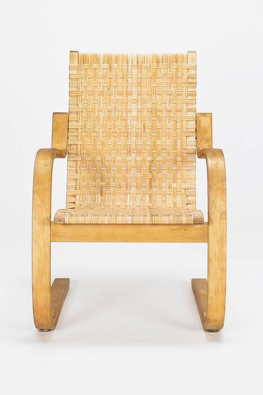 A stunning Alvar Aalto cantilever chair, model 406 designed in 1939 and manufactured by Artek in Finland in the late 1960s. Birch plywood frame with a cane webbing which was completely restored, in perfect condition!