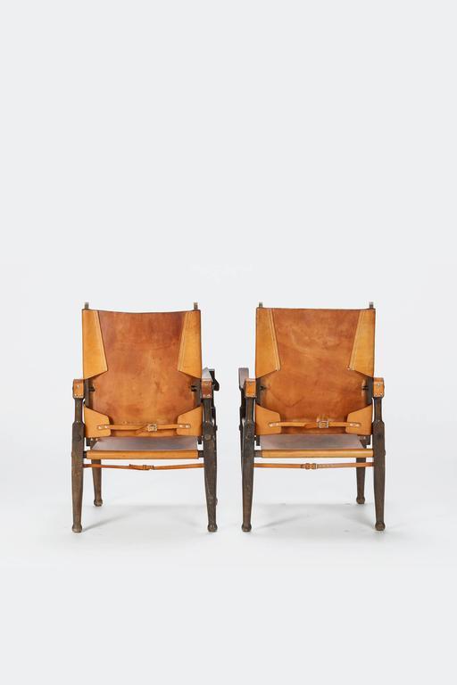 Mid-Century Modern Pair of Swiss Wilhelm Kienzle Safari Chairs Leather, 1950s For Sale