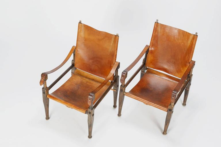 Stained Pair of Swiss Wilhelm Kienzle Safari Chairs Leather, 1950s For Sale