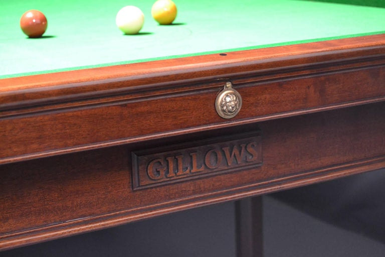 A rare 10ft x 5ft Billiard or Snooker table in the Gainsborough manner by Gillow's of Lancaster circa 1800, standing on eight elegant chamfered and shaped legs, with brass mounts fitted to the frame, legs and cushion friezes.