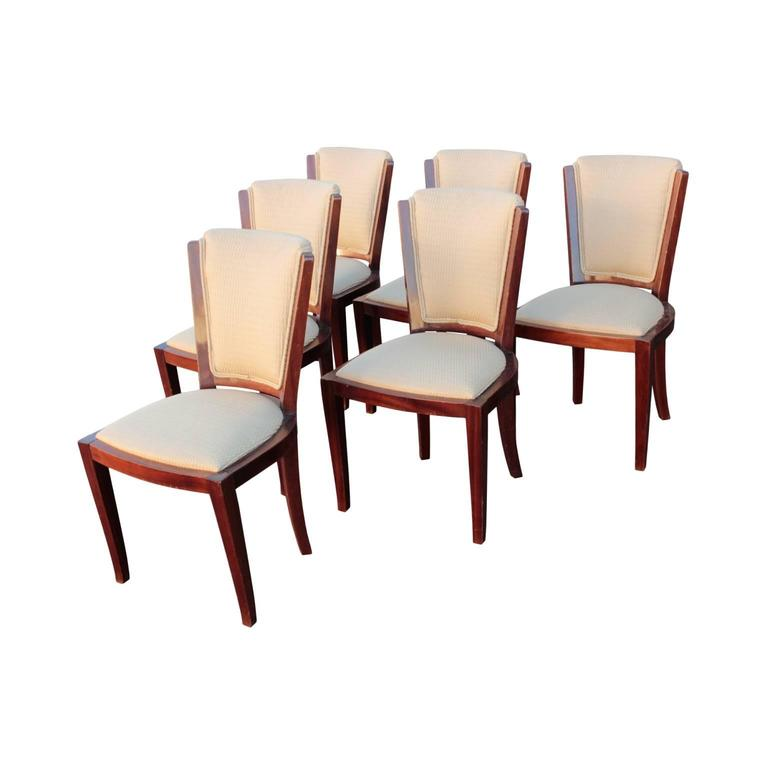 Frames in walnut, upholstered backrests and seats with Donghia silk blend.