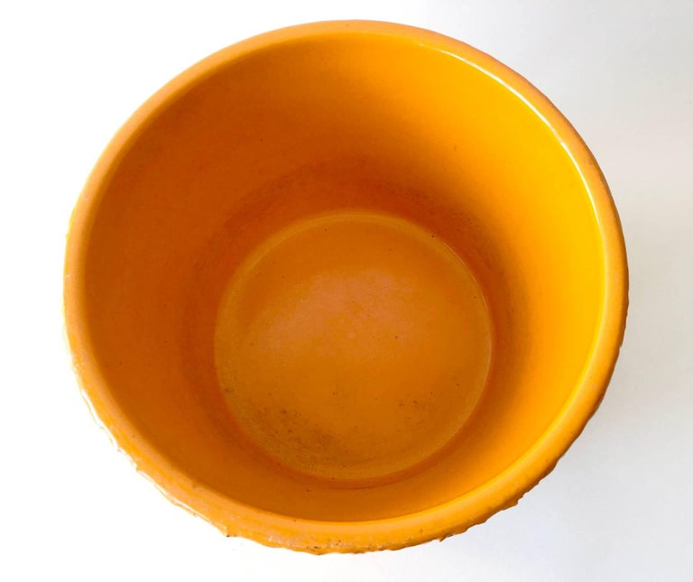 Bright orange glazed planter by David Cressey for Architectural Pottery. Planter measures 6.25