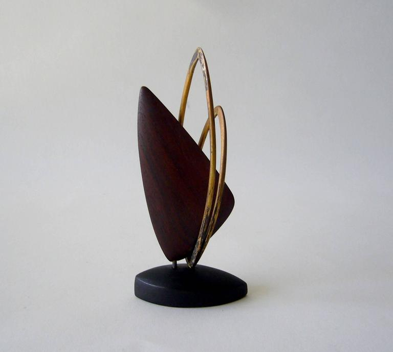 Handmade copper sculpture on wood base created by Jack Nutting of San Francisco, California. Sculpture stands 5.75