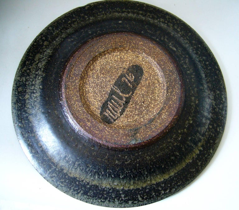 California studio stoneware charger or platter created by Raul Coronel of Los Angeles, California. Platter measures 12